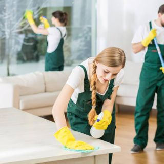 cleaners cleaning a room